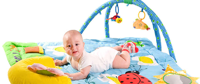 Toddler on playmat