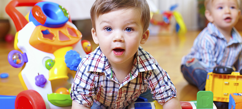curious baby boy studying nursery room